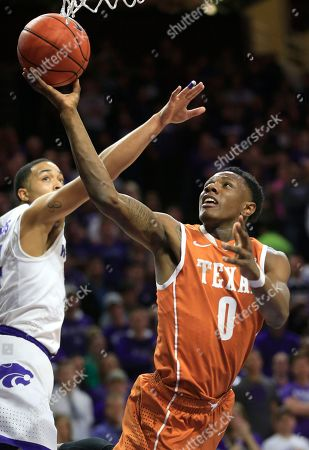 Tevin Mack, Justin Edwards Texas guard Tevin Mack (0) shoots after getting past Kansas State guard Justin Edwards, left, during the first half of an NCAA college basketball game in Manhattan, Kan