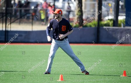 Detroit Tigers pitcher Mark Lowe runs a drill during a spring training baseball workout, in Lakeland, Fla