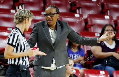 Cynthia Cooper-Dyke Southern California head coach Cynthia Cooper-Dyke, right, argues with a referee during the first half of an NCAA college basketball game against Arizona State, in Tempe, Ariz