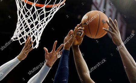 Ryan Arcidiacono, Derrick Gordon, Angel Delgado The hand of Villanova guard Ryan Arcidiacono, center, is seen as Seton Hall guard Derrick Gordon, left, and forward Angel Delgado defend during the first half of an NCAA college basketball game, in Newark, N.J