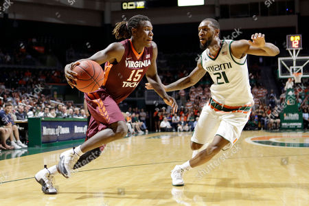 Chris Clarke, Kamari Murphy Virginia Tech guard Chris Clarke (15) drives around Miami forward Kamari Murphy (21) during the second half of an NCAA college basketball game, in Coral Gables, Fla. Miami won 65-49