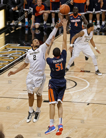 Darius Thompson, Devin Thomas Virginia's Darius Thompson (51) shoots his game-winning basket over Wake Forest's Devin Thomas (2) in the second half of an NCAA college basketball game in Winston-Salem, N.C., . Virginia won 72-71