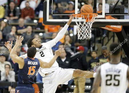 Devin Thomas, Malcolm Brogdon Wake Forest's Devin Thomas, back, dunks against Virginia's Malcolm Brogdon, front, in the second half of an NCAA college basketball game in Winston-Salem, N.C., . Virginia won 72-71