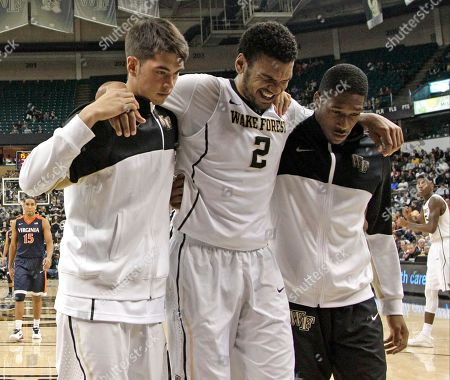 Devin Thomas Wake Forest's Devin Thomas (2) is helped off the court by teammates after being injured in the second half of an NCAA college basketball game against Virginia in Winston-Salem, N.C., . Virginia won 72-71