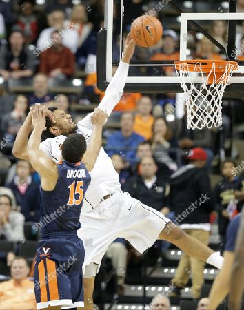 Devin Thomas, Malcolm Brogdon Wake Forest's Devin Thomas, back, is fouled by Virginia's Malcolm Brogdon, front, in the second half of an NCAA college basketball game in Winston-Salem, N.C., . Virginia won 72-71