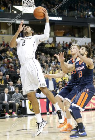 Devin Thomas, Anthony Gill Wake Forest's Devin Thomas (2) drives past Virginia's Anthony Gill (13) in the first half of an NCAA college basketball game in Winston-Salem, N.C