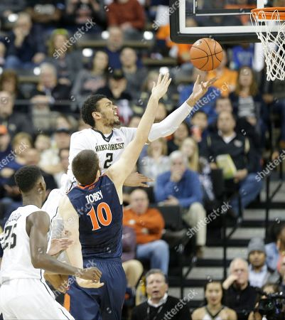 Devin Thomas, Mike Tobey Wake Forest's Devin Thomas (2) drives past Virginia's Mike Tobey (10) in the second half of an NCAA college basketball game in Winston-Salem, N.C., . Virginia won 72-71