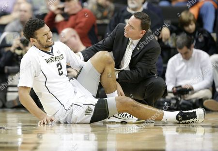 Devin Thomas A trainer tends to Wake Forest's Devin Thomas (2) after he was injured in the second half of an NCAA college basketball game against Virginia in Winston-Salem, N.C., . Virginia won 72-71