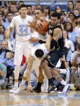 Marcus Paige, Justin Jackson, Brice Johnson, Devin Thomas North Carolina's Marcus Paige, front, and Brice Johnson struggle Wake Forest's Devin Thomas, right, during the first half of an NCAA college basketball game in Chapel Hill, N.C., . North Carolina's Justin Jackson (44) watches at rear