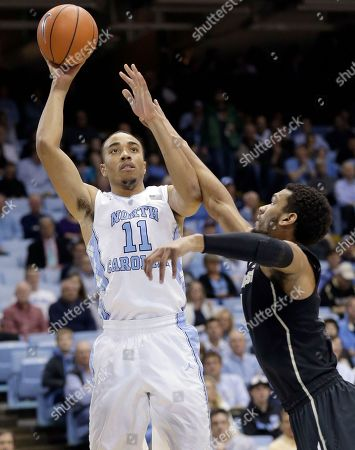 Brice Johnson, Devin Thomas North Carolina's Brice Johnson (11) shoots over Wake Forest's Devin Thomas during the first half of an NCAA college basketball game in Chapel Hill, N.C., . North Carolina won 83-68