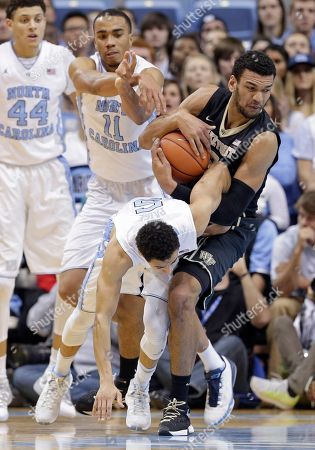 Justin Jackson, Marcus Paige, Brice Johnson, Devin Thomas North Carolina's Marcus Paige (5) and Brice Johnson (11) struggle Wake Forest's Devin Thomas, right, during the first half of an NCAA college basketball game in Chapel Hill, N.C., . North Carolina's Justin Jackson (44) watches at rear