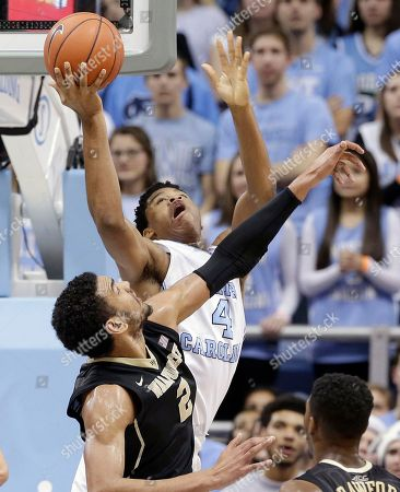 Isaiah Hicks, Devin Thomas North Carolina's Isaiah Hicks (4) drives under the basket as Wake Forest's Devin Thomas (2) defends during the second half of an NCAA college basketball game in Chapel Hill, N.C., . North Carolina won 83-68