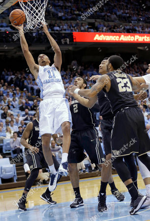 Brice Johnson, Devin Thomas, Rondale Watson, John Collins North Carolina's Brice Johnson (11) shoots as Wake Forest's Devin Thomas (2), Rondale Watson (23) and John Collins defend during the first half of an NCAA college basketball game in Chapel Hill, N.C