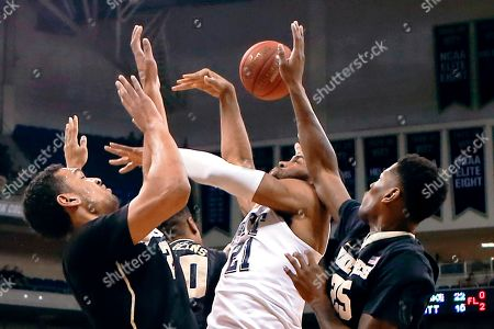 Sheldon Jeter, John Collins, Devin Thomas, Cornelius Hudson Pittsburgh's Sheldon Jeter (21) and Wake Forest's Devin Thomas, left, Cornelius Hudson (25) and John Collins (20) battle for a rebound during the first half of an NCAA college basketball game, in Pittsburgh