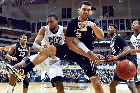 Sheldon Jeter, Devin Thomas Pittsburgh's Sheldon Jeter (21) and Wake Forest's Devin Thomas (2) battle for a rebound as the ball gets away during the first half of an NCAA college basketball game, in Pittsburgh