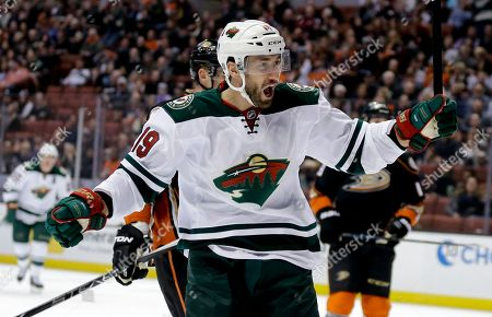Minnesota Wild center Jarret Stoll celebrates after scoring during the first period of an NHL hockey game against the Anaheim Ducks in Anaheim, Calif