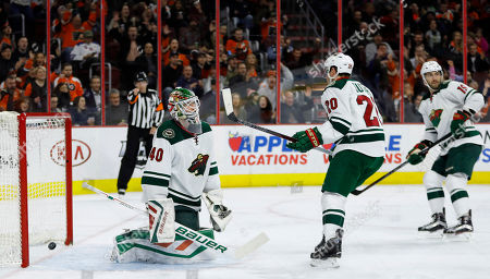 Devan Dubnyk Minnesota Wild's Devan Dubnyk (40) reacts after giving up a goal to Philadelphia Flyers' Mark Streit as Ryan Suter (20) and Jarret Stoll (19) skate by during the second period of an NHL hockey game, in Philadelphia