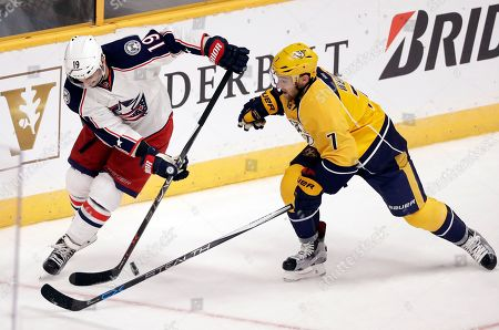 Jarret Stoll, Yannick Weber Columbus Blue Jackets center Jarret Stoll (19) battles for the puck with Nashville Predators defenseman Yannick Weber (7), of Switzerland, during the first period of an NHL hockey preseason game, in Nashville, Tenn