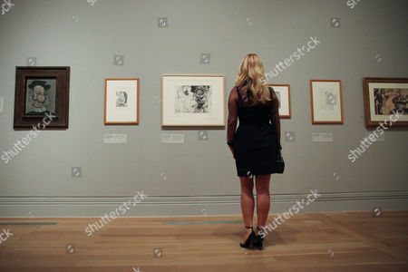 Diana Widmaier-Picasso (granddaughter) looks at her grandfather's portraits.