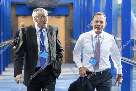 Sir Michael Hintze (left) and former Australian prime minister Tony Abbott attend the 2016 Conservative Party Conference.