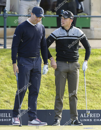 European Ryder Cup player Danny Willett (r) warms up with former England cricket captain Michael Vaughan before playing a practice round at The Alfred Dunhill Links Championship at The Old Course, St. Andrews, Scotland on 5th October
