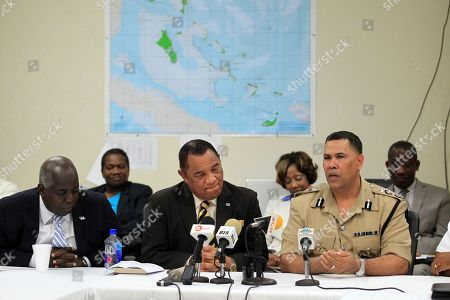 Bahamas Commissioner of Police Ellison Greenslade, right, speaks at a press conference while Prime Minister Perry Christie, center, and Deputy Prime Minister Philip Davis look on during a special meeting at the NEMA (National Emergency Management Agency) headquarters in Nassau, Bahamas, . Commissioner Greenslade made a passionate plea for all residents of the Bahamas to heed the advice of the emergency services if asked to evacuate their homes and move to higher ground as storm surges are expected to reach 15 feet