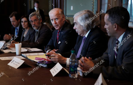 Joe Biden, Ernest Moniz Vice President Joe Biden, third from right, joined by Energy Secretary Ernest Moniz, second from right, speaks during a meeting of the Cancer Moonshot Task Force at the Eisenhower Executive Office Building on the White House complex, in Washington