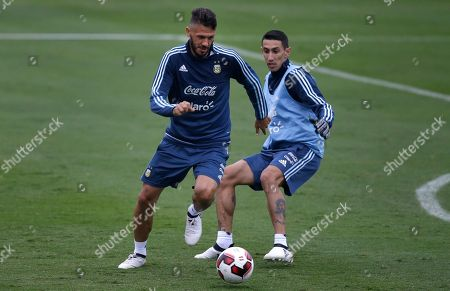 Martin Demichelis, Angel Di Maria Argentina's Martin Demichelis, left, passes Angel Di Maria during a training session in Lima, Peru, . Argentina will face Peru in a World Cup qualifying soccer game in Lima, Thursday, Oct. 6