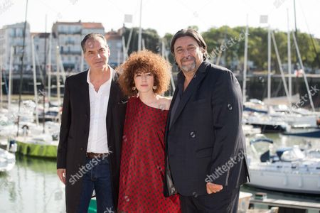 Blandine Bellavoir, Samuel Labarthe and Dominique Thomas pose at photocall for 'Les petits meutres'