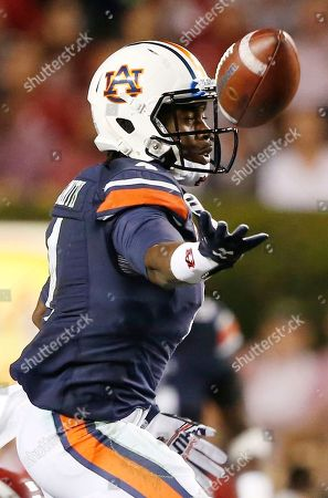 Jason Smith Auburn wide receiver Jason Smith (4) tips a pass to himself before scoring a touchdown during the second half of an NCAA college football game against Alabama, in Auburn, Ala