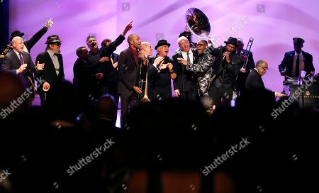 Musicians and speakers, including New Orleans Mayor Mitch Landrieu, Dr. John, John Boutte, John Cleary, Deacon John Moore, Jimmy Buffet, Boz Scaggs, Cyril Neville and the Preservation Hall Jazz Band sing a grand finale at a tribute for legendary New Orleans composer and recording artist Allen Toussaint, who died last week at the age of 77, in New Orleans