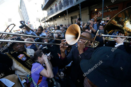 Jazz musicians perform a second line after a funeral tribute to New Orleans songwriter, producer and recording artist Allen Toussaint in New Orleans, . New Orleans and lovers of New Orleans' rich musical heritage crowded into a historic theater Friday and bid goodbye in words and song to Allen Toussaint, a prolific songwriter, performer and producer who died last week at age 77