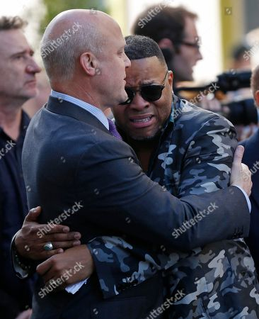 Mitch Landrieu, Davell Crawford Musician Davell Crawford, right, hugs New Orleans Mayor Mitch Landrieu after a funeral tribute to New Orleans songwriter and recording artist Allen Toussaint in New Orleans, . New Orleans and lovers of New Orleans' rich musical heritage crowded into the historic Orpheum theater Friday and bid goodbye in words and song to Toussaint, a prolific songwriter, performer and producer who died last week at age 77
