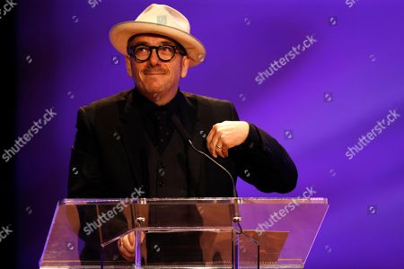 Elvis Costello Elvis Costello smiles as he talks of his friendship during a funeral tribute to Allen Toussaint in New Orleans, . New Orleans and lovers of New Orleans' rich musical heritage crowded into the historic Orpheum theater Friday and bid goodbye in words and song to Toussaint, a prolific songwriter, performer and producer who died last week at age 77