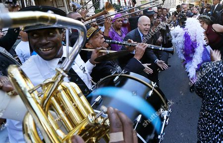 Mitch Landrieu New Orleans Mayor Mitch Landrieu, top right, dances as jazz musicians perform a second line after a funeral tribute to New Orleans songwriter, producer and recording artist Allen Toussaint in New Orleans, . New Orleans and lovers of New Orleans' rich musical heritage crowded into the historic Orpheum theater Friday and bid goodbye in words and song to Allen Toussaint, a prolific songwriter, performer and producer who died last week at age 77