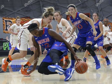 Taylor Williams, Michelle Holmes American University forward Michelle Holmes (12) tries to control the ball as forward Princeton forward Taylor Williams (22) tries to make a steal during the first half of an NCAA college basketball game, in Princeton, N.J