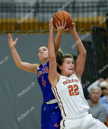 Stock Image of Taylor Williams, Michelle Holmes American University guard Emily Kinneston (4) tries to steal the ball as Princeton forward Taylor Williams (22) holds on during the second half of an NCAA college basketball game, in Princeton, N.J