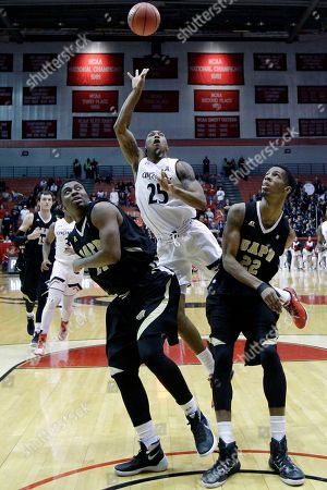 Kevin Johnson, Larry Johnson, JoVaughn Love Cincinnati's Kevin Johnson (25) shoots for two points against Arkansas-Pine Bluff's Larry Johnson, left, and JoVaughn Love (22) during the second half of an NCAA college basketball game, in Cincinnati. Cincinnati won 99-50