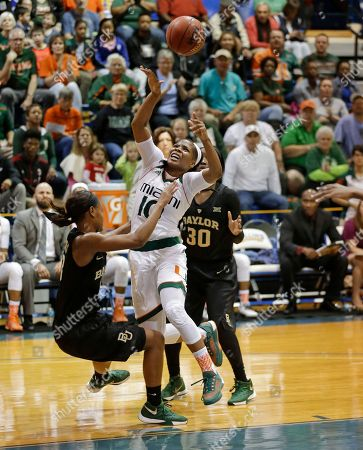 Nina Davis, Michelle Woods, Alexis Jones Miami guard Michelle Woods (10) is fouled by Baylor forward Nina Davis, left, as she gets past guard Alexis Jones (30) during the second half of an NCAA college basketball game, in Winter Park, Fla. Baylor won 88-81