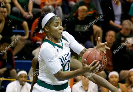 Miami guard Michelle Woods (10) grabs a rebound against Baylor during the first half of an NCAA college basketball game, in Winter Park, Fla