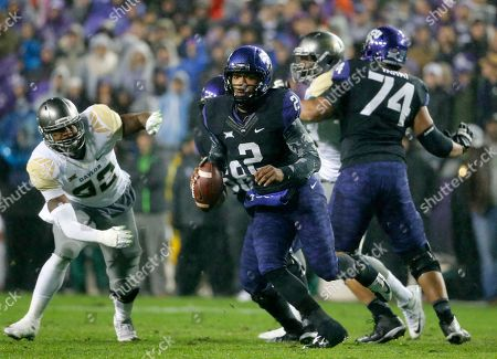 Trevone Boykin, Jamal Palmer TCU quarterback Trevone Boykin keeps the ball and gains yardage on a run as Baylor defensive end Jamal Palmer (92) gives chase in the first half of an NCAA college football game, in Fort Worth, Texas