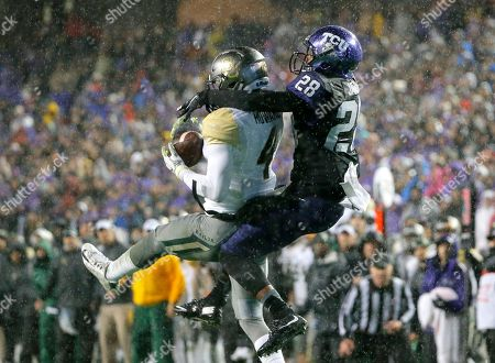 Xavien Howard, Tony James Baylor cornerback Xavien Howard, left, intercepts a pass intended for TCU wide receiver Tony James, right, in the first half of an NCAA college football game, in Fort Worth, Texas