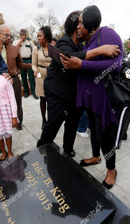 Karen King Williams, Patty King Patty King, right, hugs her sister Karen King Williams, following the unveiling of a ledger black granite gravesite marker that will eventually be the centerpiece of a memorial courtyard of their father, blues legend B.B. King in Indianola, Miss., . King died in May and is buried at the B.B. King Museum and Delta Interpretive Center in his Mississippi hometown