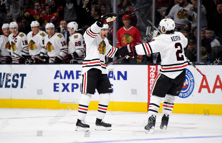 Patrick Kane, Duncan Keith Chicago Blackhawks right wing Patrick Kane, left, celebrates his goal with defenseman Duncan Keith during the first half of an NHL hockey game against the Los Angeles Kings in Los Angeles. Kane's second-period goal against Minnesota on Tuesday, Dec. 1, extended his point streak to 20 games, one shy of the franchise record set by Hall of Famer Bobby Hull during the 1971-72 season