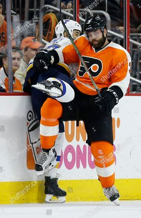 Radko Gudas, Scott Gomez Philadelphia Flyers' Radko Gudas, right, checks St. Louis Blues' Scott Gomez into the boards during the second period of an NHL hockey game, in Philadelphia