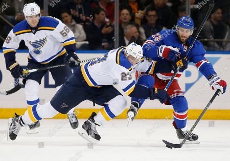 Dmitrij Jaskin, Jarrett Stoll St. Louis Blues right wing Dmitrij Jaskin (23) defends against New York Rangers center Jarret Stoll (26) in the second period of an NHL hockey game in New York