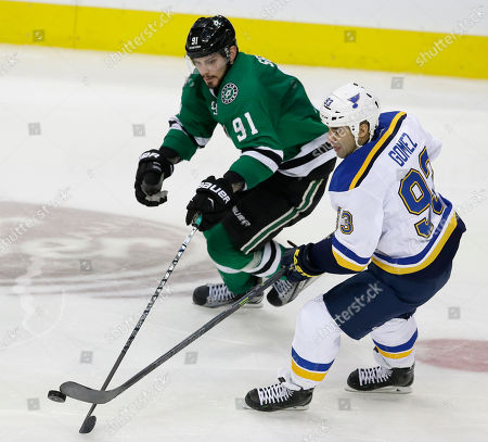 Stock Picture of Scott Gomez, Tyler Seguin St. Louis Blues center Scott Gomez (93) and Dallas Stars center Tyler Seguin (91) skate for the puck during the third period of an NHL hockey game, in Dallas