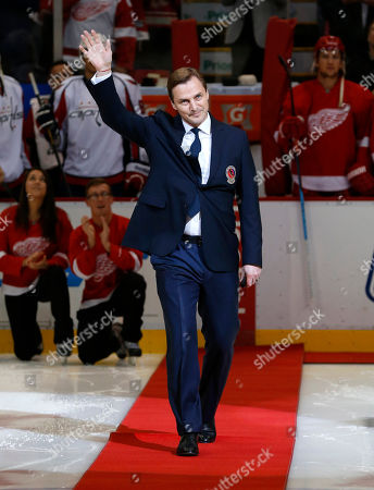 Stock Image of Sergei Fedorov Former Detroit Red Wings forward Sergei Fedorov waves before dropping a ceremonial puck before an NHL hockey game against the Washington Capitals in Detroit. Fedorov was recently inducted into the Hockey Hall of Fame