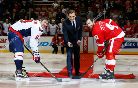 Stock Photo of Sergei Fedorov Former Detroit Red Wings forward Sergei Fedorov drops a ceremonial puck with Washington Capitals left wing Alex Ovechkin (8) and Detroit Red Wings left wing Henrik Zetterberg (40) before an NHL hockey game in Detroit. Fedorov was recently inducted into the Hockey Hall of Fame