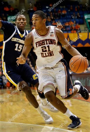 Illinois guard Malcolm Hill (21) drives around Chattanooga guard Eric Robertson (15) during the first half of an NCAA college basketball game at the Prairie Capital Convention Center, in Springfield, Ill. Chattanooga defeated Illinois 81-77